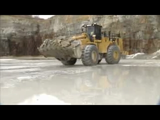 AFTER >: CAT 992K Wheel Loader Carrying Material